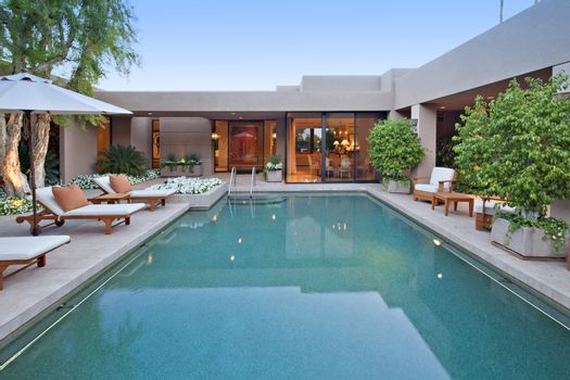 House exterior with pool at dusk