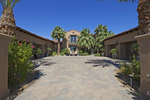 View up the driveway of luxury villa