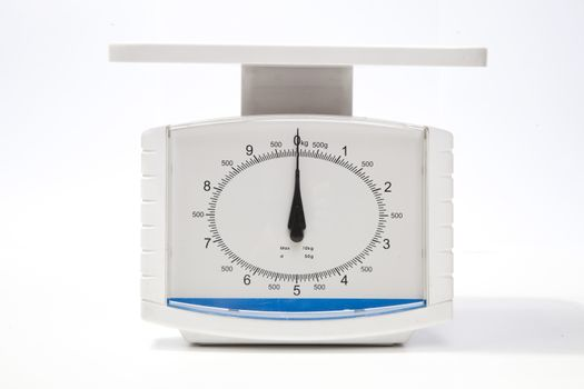 Kitchen weighing scale over white background