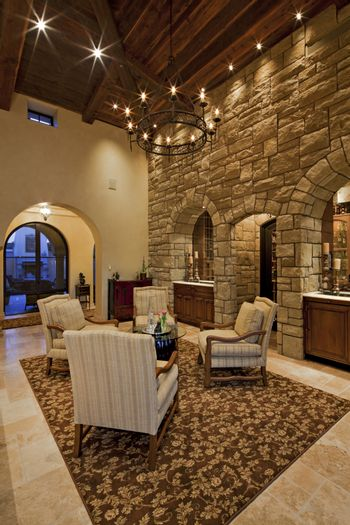Stylish living room with high ceiling