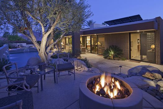 Outdoor fire place by a pool
