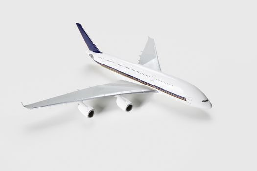 Model airplane over white background