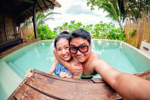 Asian couple love in swiming pool