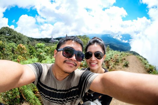 Couole love  selfie in Highest mountain at Thailand