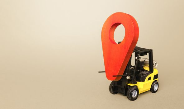 Yellow forklift carries a red location pointer. Transportation services and logistics management warehouse. Destination cargo and parcels, tracking. Efficient express delivery system.