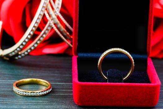Close up diamond  wedding ring in red jewel box