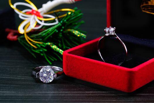 Close up diamond ring in red jewel box