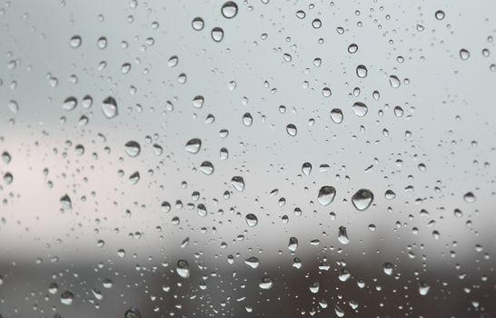 Drops of rain on the window, shallow dof