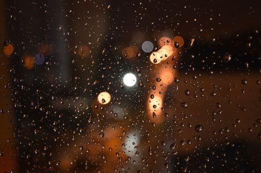 Rain drops on night window, shallow dof