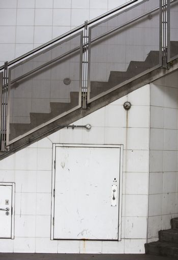 Closed door on wall and stairway