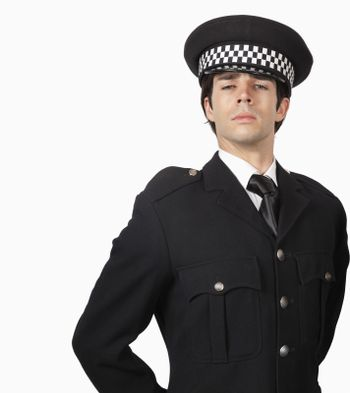 Portrait of confident police officer against white background