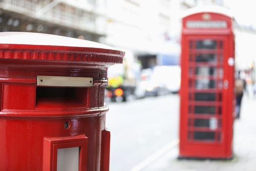 Red telephone booth and mail box
