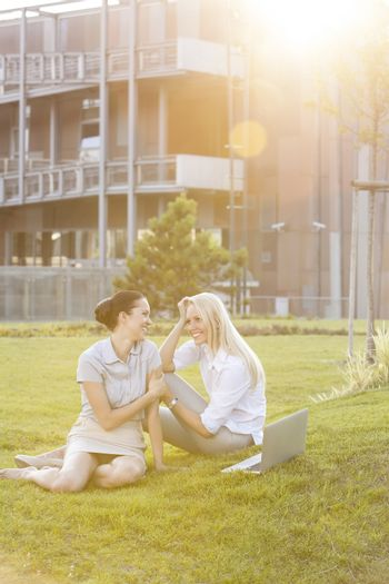 Young businesswomen gossiping in office lawn