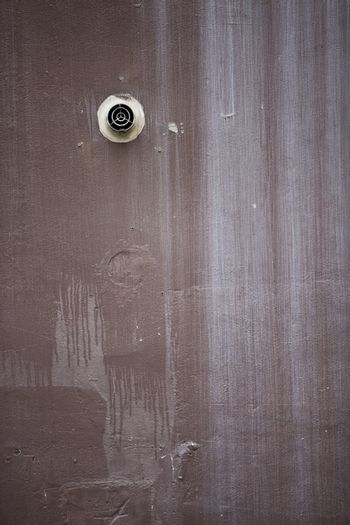 Full frame shot of wooden wall with an exhaust vent