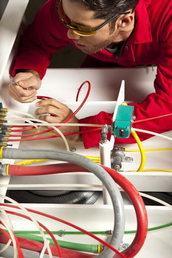 Technician inspecting colorful wiring circuit