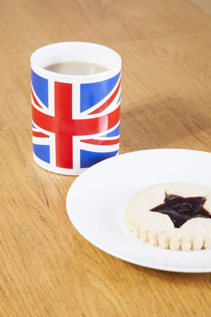 British coffee mug and cookie on plate