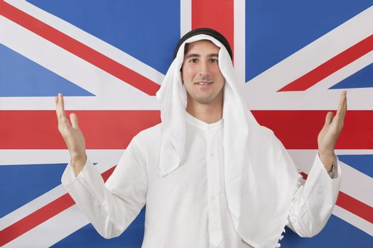 Portrait of an Arab man in traditional clothes against United kingdom flag