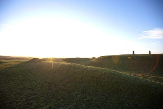 Sun flare over Hill of Tara, Ireland