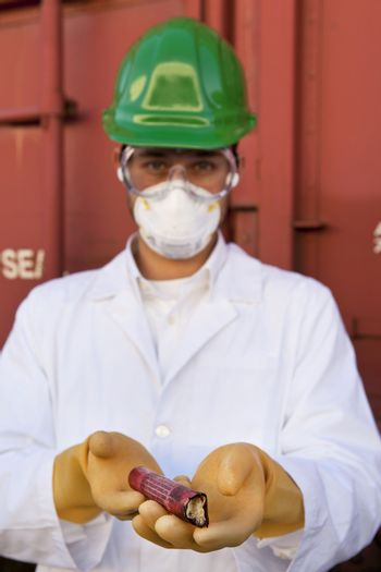 Safety inspector holding explosive material