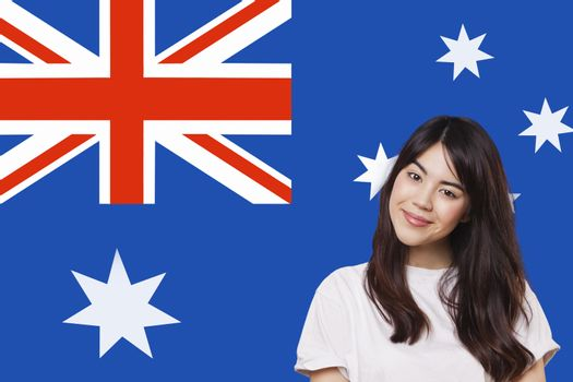 Portrait of smiling mixed race young woman against Australian flag