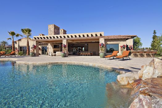 House exterior with pool and waterfall