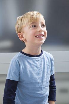 Cute Caucasian boy looking away