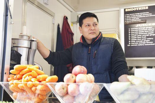 Male vendor at juice center