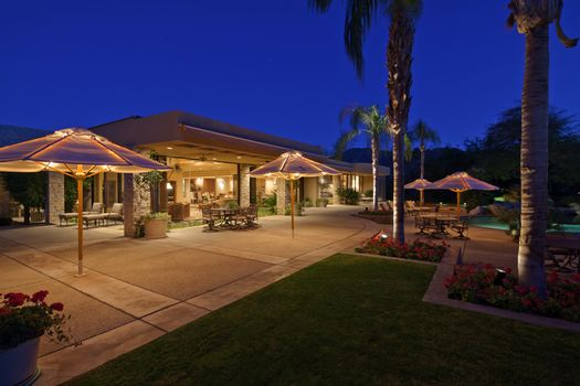 Looking over patio to outdoor seating area of luxury home