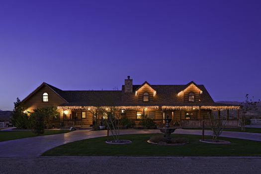 Façade of ranch home at dusk