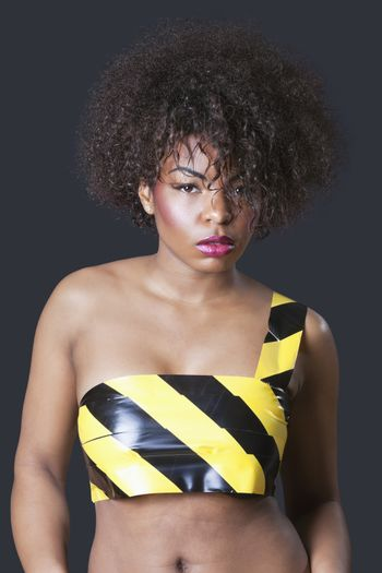 Portrait of caution tape on nude sensuous African American female