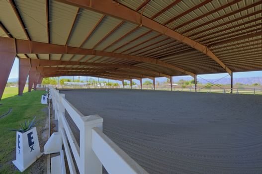 Covered Horse training area with timber fencing
