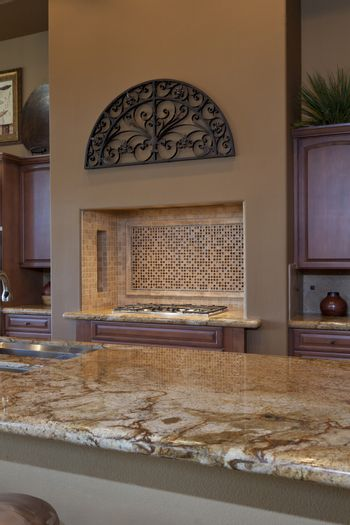 View over counter to stove in traditional kitchen