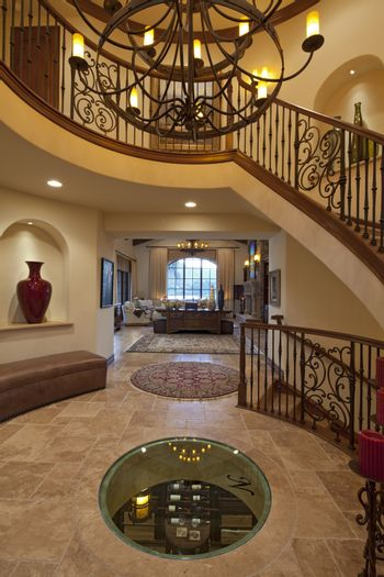 Luxurious foyer with staircase of spacious home