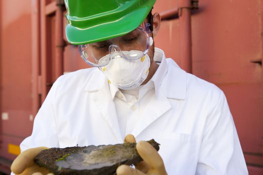 Safety inspector holding biological material