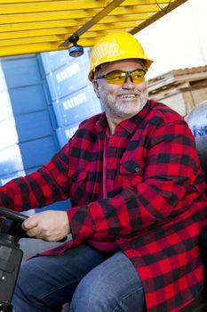 Portrait of Construction worker driving forklift
