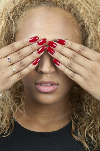 Mixed race young woman covering eyes