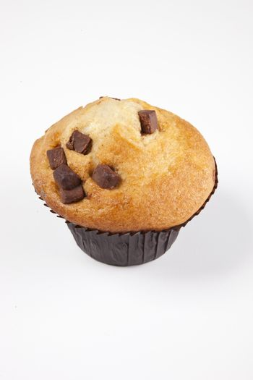 Freshly baked muffin over white background