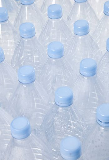 Close-up view of empty plastic bottles with blue caps
