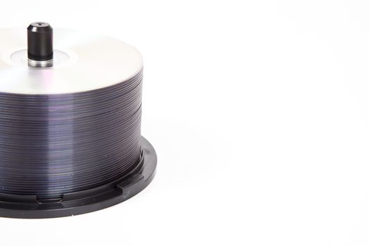 Stack of CDs on a spindle over white background