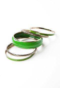 Green bangles over white background