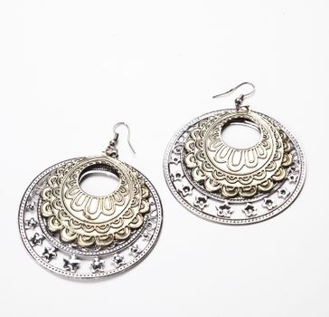 Beautiful traditional earrings over white background