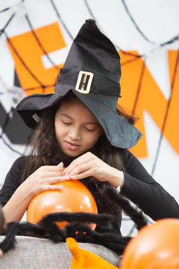 Happy Halloween, a girl prepare the colorful balloon in decorate
