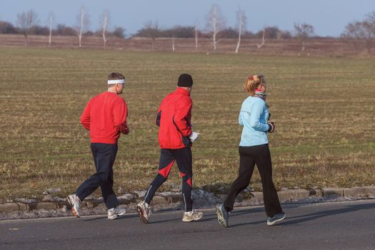 Three runners while training for a competition