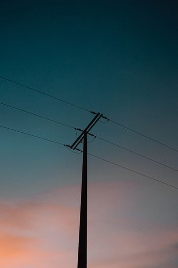 A moody electrical post during the blue hour