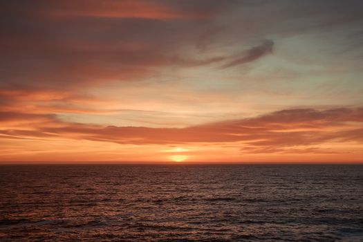 A massive horizon during a colorful sunset