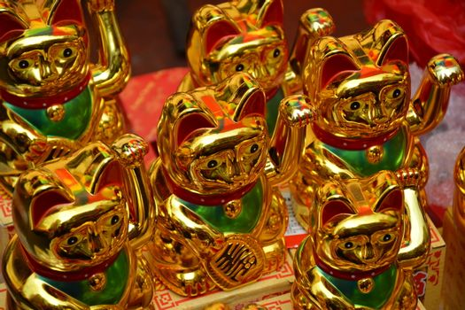 Golden cat lucky charm figurine