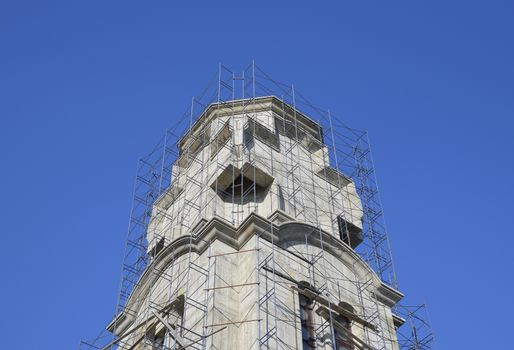 Construction of an Orthodox chapel. Scaffolds along the walls of the building.