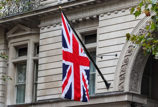 United Kingdom flag at a flagpole moving slowly in the wind agai