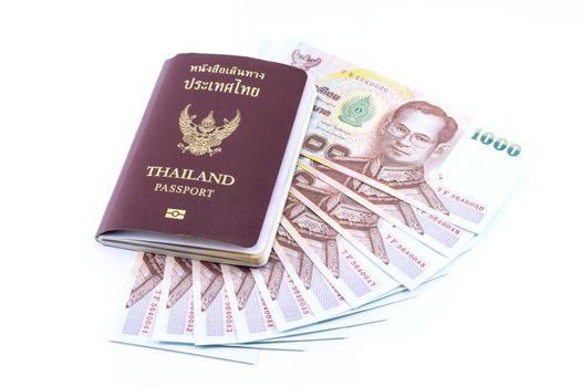 Thai Money 1000 Bath and Thailand passport isolated on white background