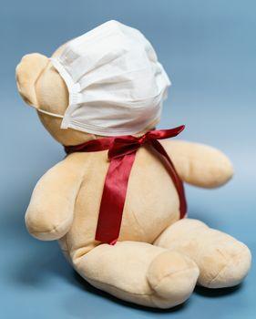Teddy bear wearing face mask. Protection epidemic Coronavirus, C